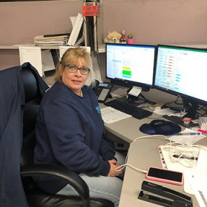 Sheri Pike working at her desk