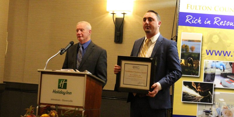LA Transport, Inc./Universal Warehousing, Inc. General Manager Andrew Olbrych, left, and Vice President Dave Groff are presented with the Large Established Business Award